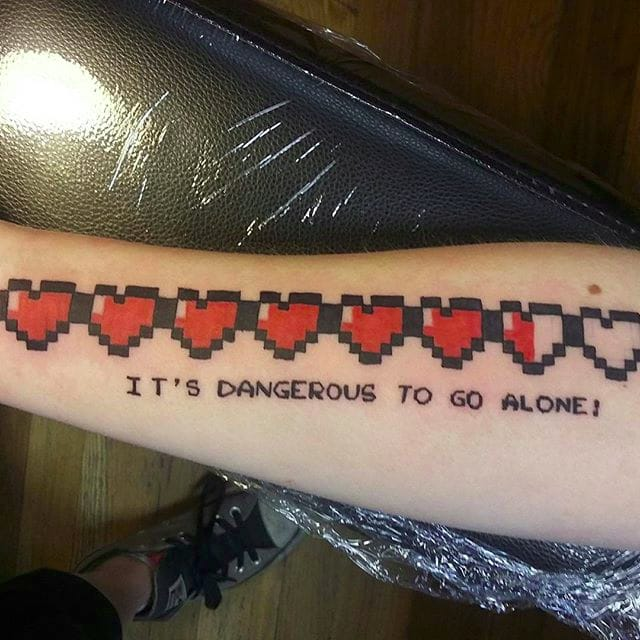 Keeping The '80s Alive With 8-Bit Tattoos