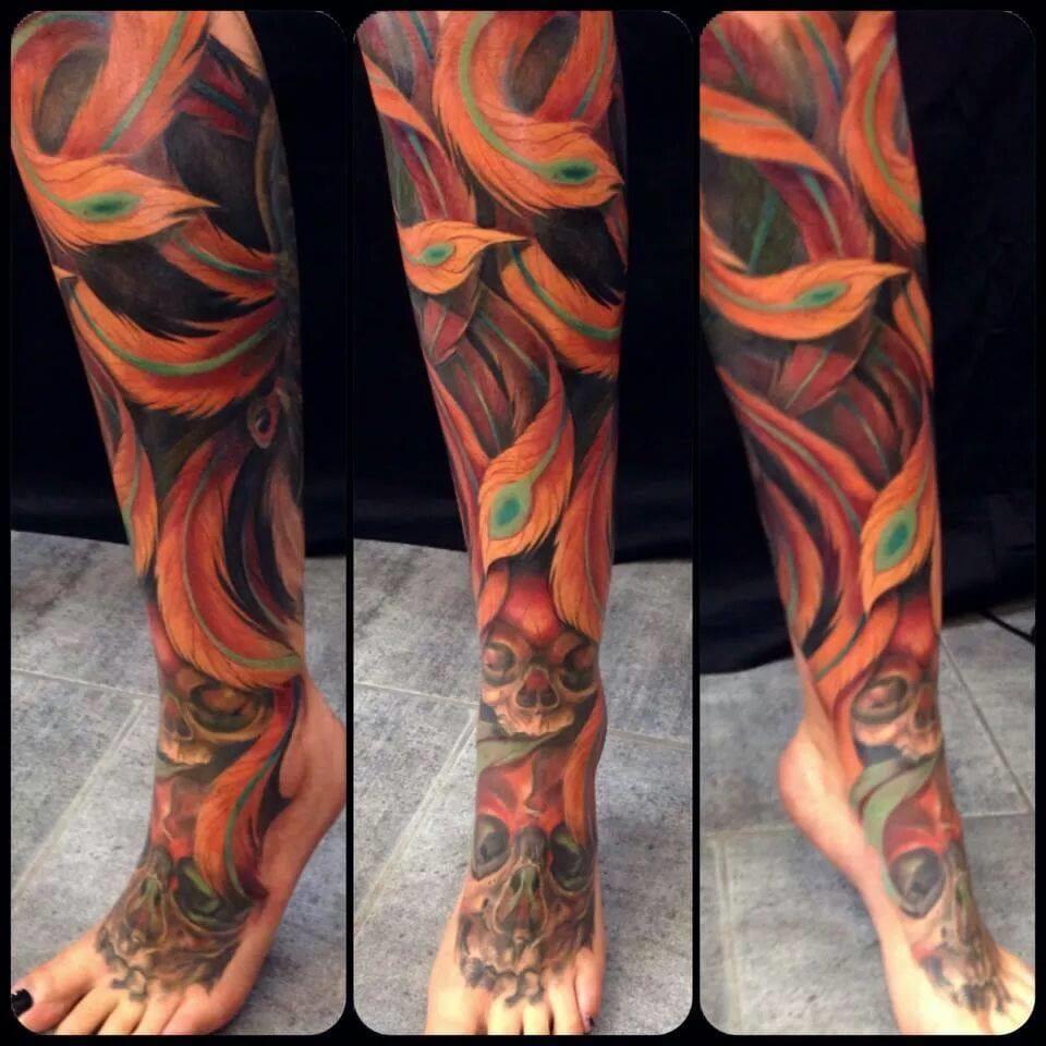 Fiery phoenix feathers and skulls by Julien Thibers...
