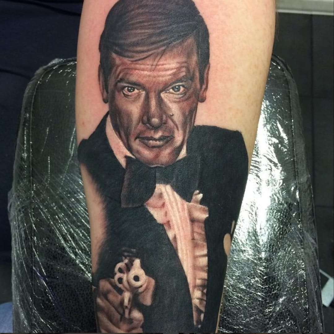 Honoring Sir Roger Moore with James Bond Tattoos