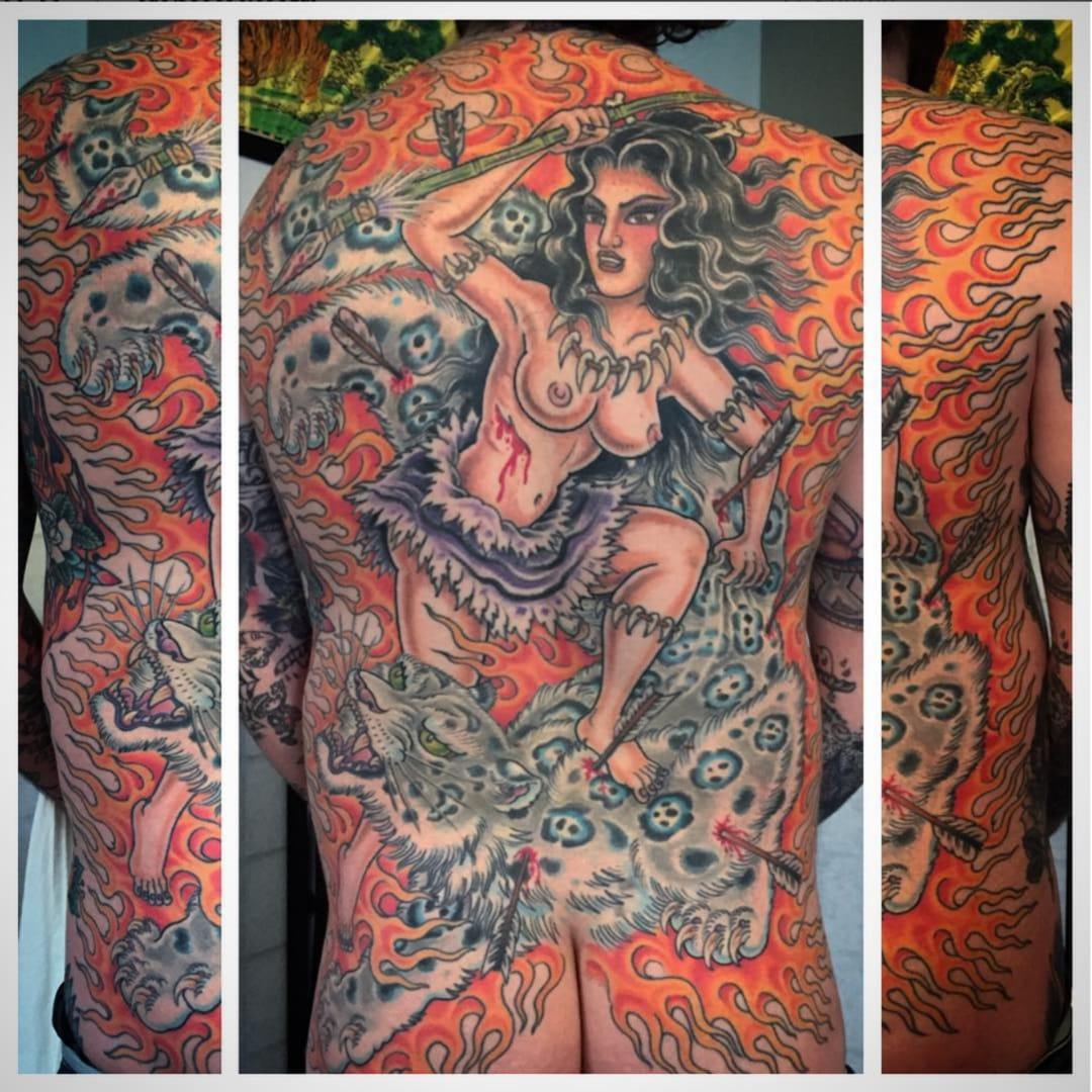 The Painter Behind Tattoos of Babes Battling Ferocious Beasts