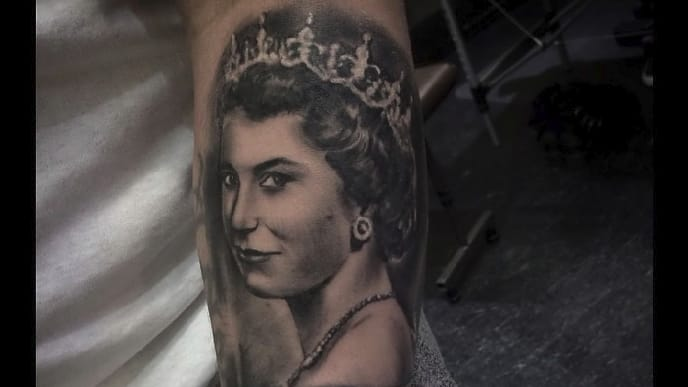 Royally Cool Portrait Tattoos of Queen Elizabeth II