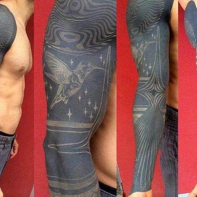White Ink Over Blackwork Tattoos