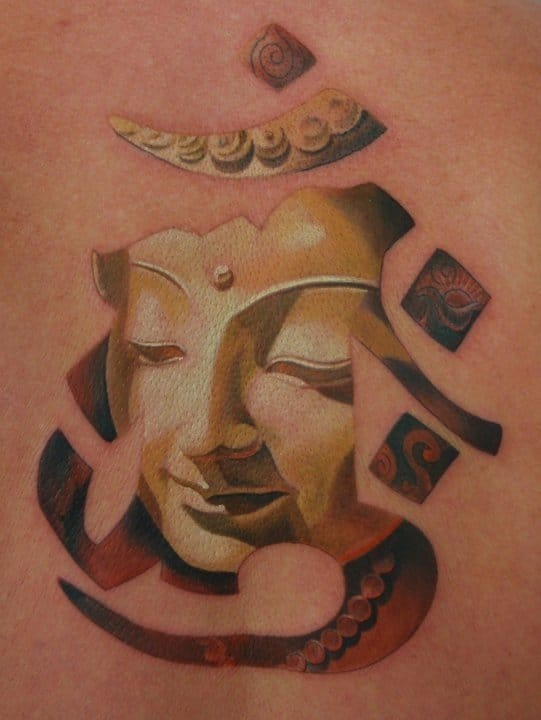Amazing use of the om with a realistic Buddha tattoo by Pepa!