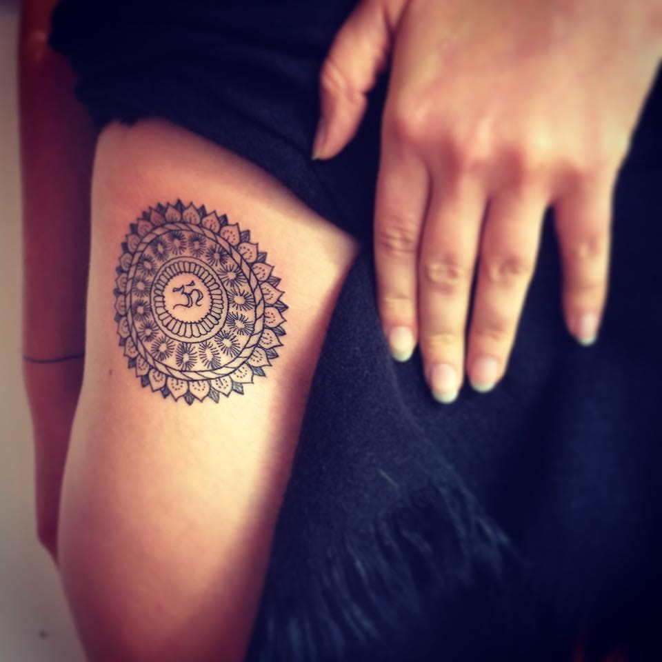 Om tattoos are often found in mandalas. By Faustink.