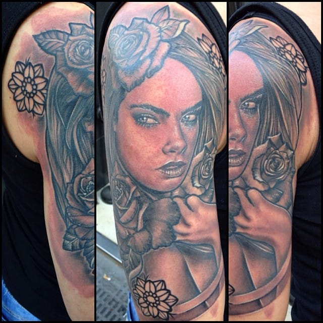 Cara Delevingne is making the buzz with her tattoos. By Julian Arias.