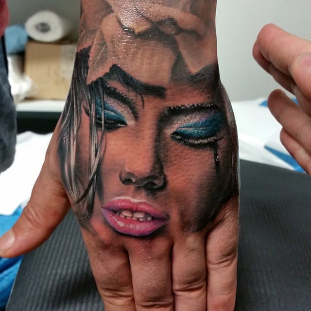 Adriana on the hand by Szalai Tibor. But I guess you'd rather put your hand on Adriana lol.