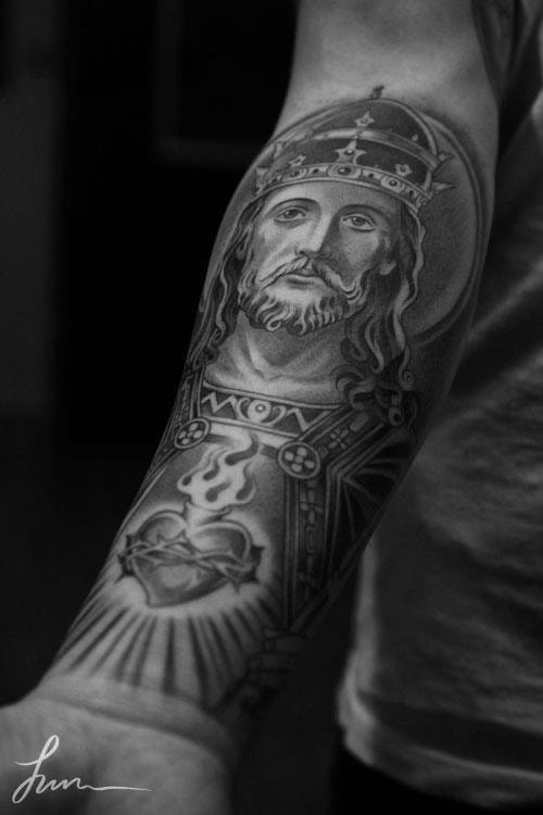 Sacred heart tattoos are also part of Jesus Christ's portraits. Here by Jun Cha.