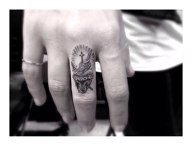An intricate finger tattoo by Dr Woo...