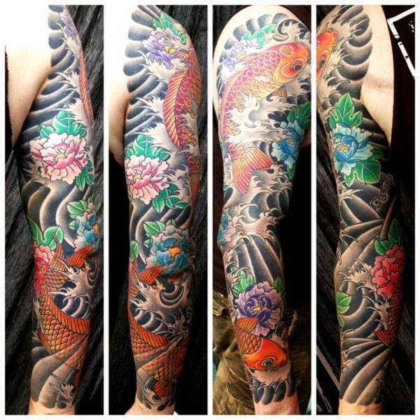 Awesome sleeve by Saved Tattoo