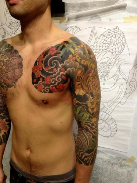 Chest and sleeve by Seventh Son Tattoo