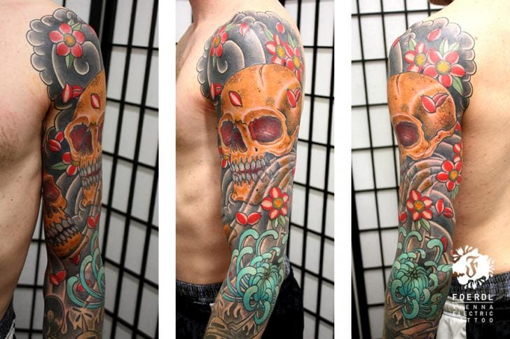 Skull and flower sleeve by Vienna Electric Tattoo
