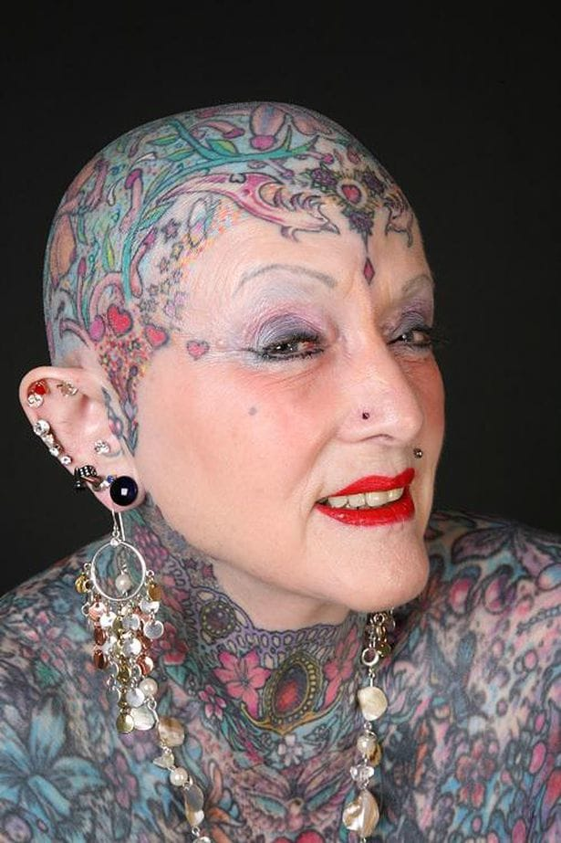 Some of her tattoos were erotic, some other pretty or meaningful. She also had many piercings.