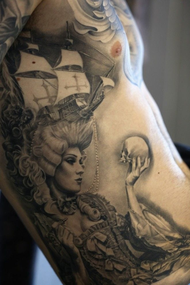 What a beautiful Rib piece! Check out what the Victorian woman's holding in her right hand! Awesome!