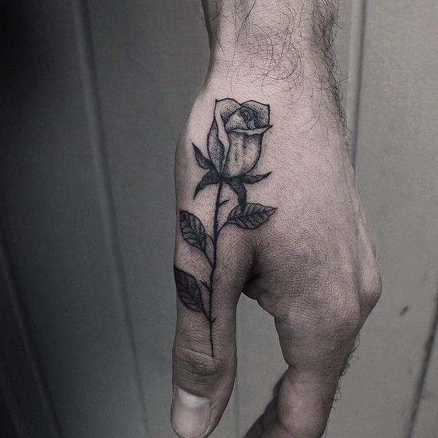 Lovely rose on the thumb by Alexander James!