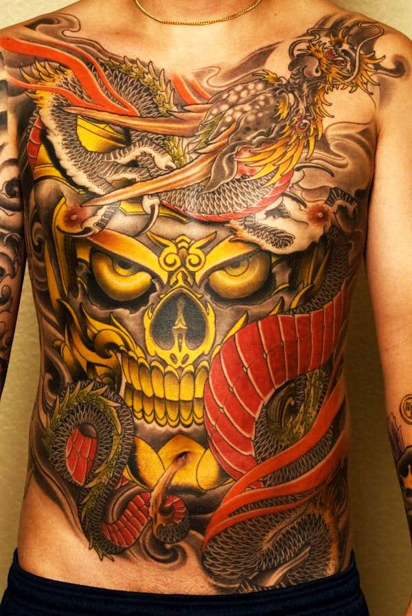 B - E - A -utifully Done Japanese tattoo by Bill Canales in San Diego California at Full Circle Tattoo #japanese #japanesestyle #japanesetattoo #yellowdragon #dragon #chestpiece #BillCanales