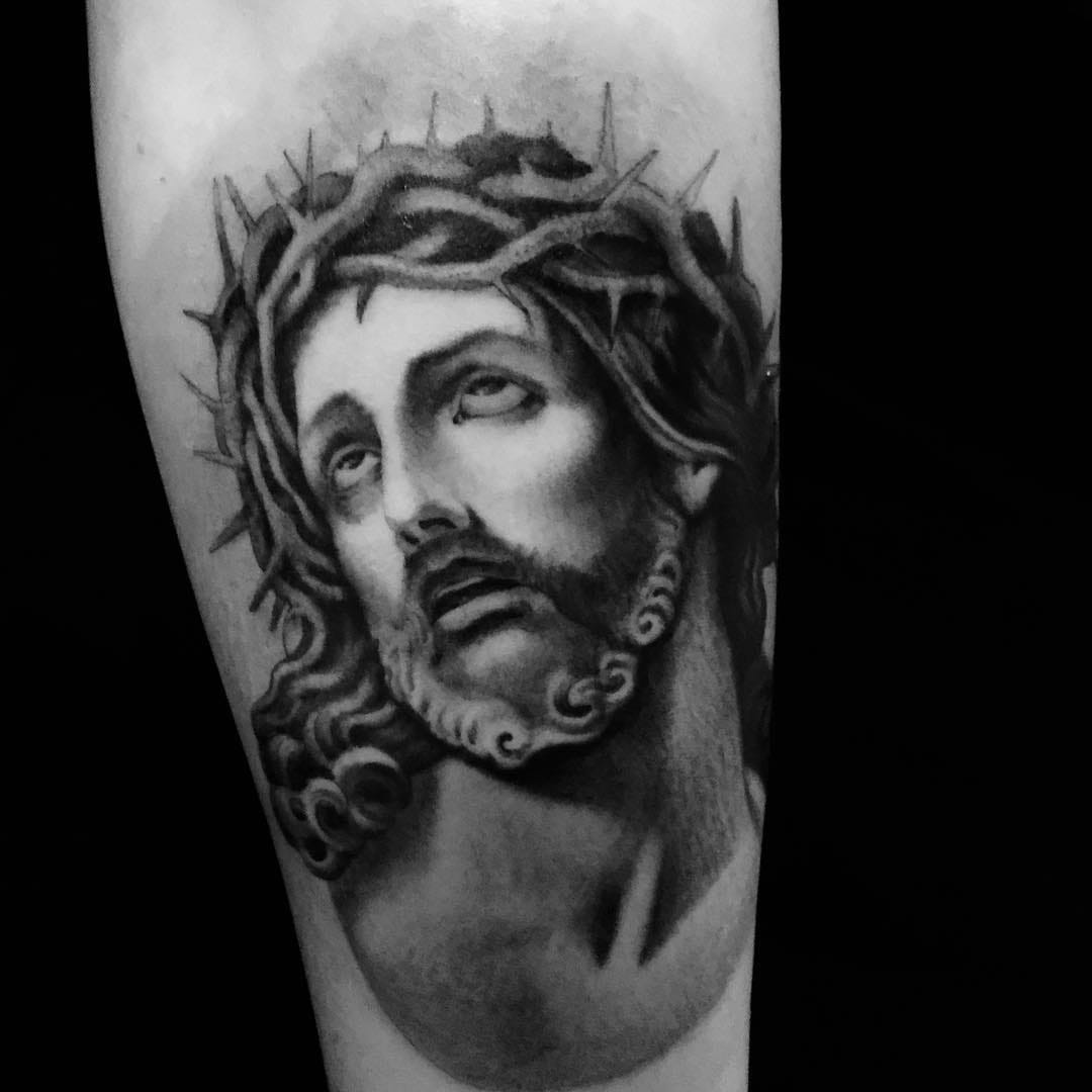 In God We Trust: Religious Tattoos for Tattoo of the Day