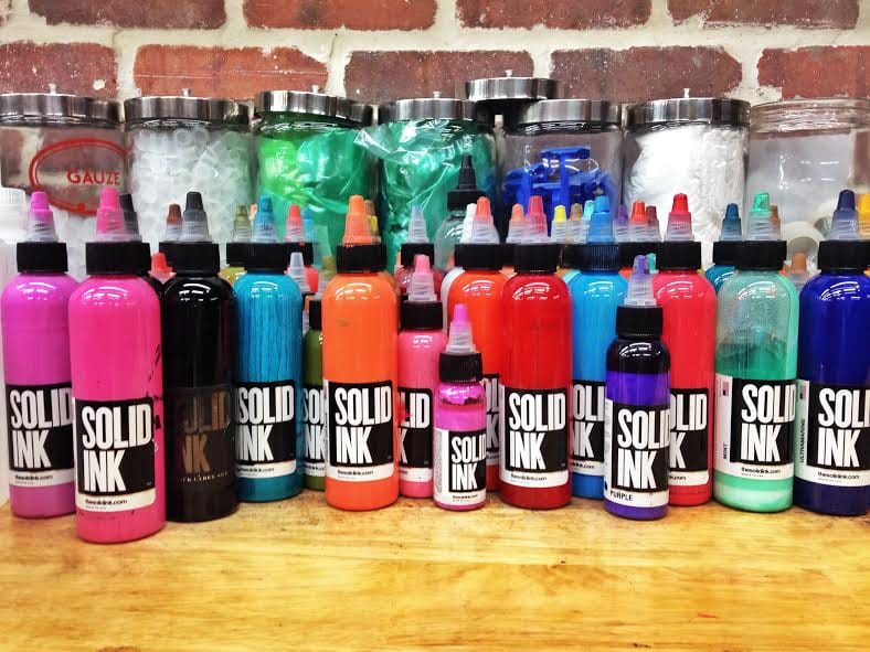 The Solid Ink colorfully displayed on a work station. This is one of the industry's premiere tattoo pigments.