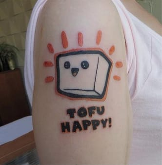 Who can resist this happy block of tofu by @caspermacabre_tattoos ?