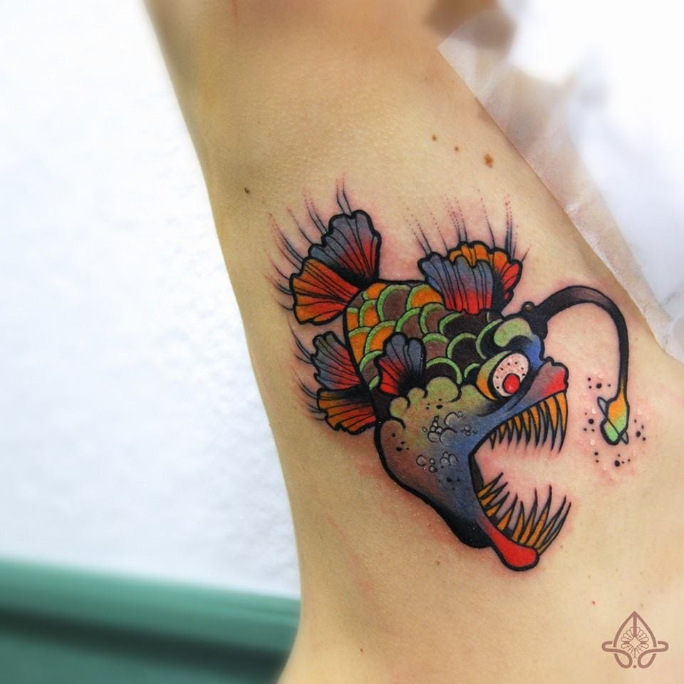 Colorful lantern fish tattoo by Anais Allnt.