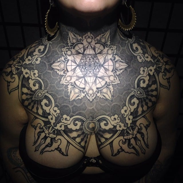 16 Admirable Geometric And Ornamental Chest Piece Tattoos