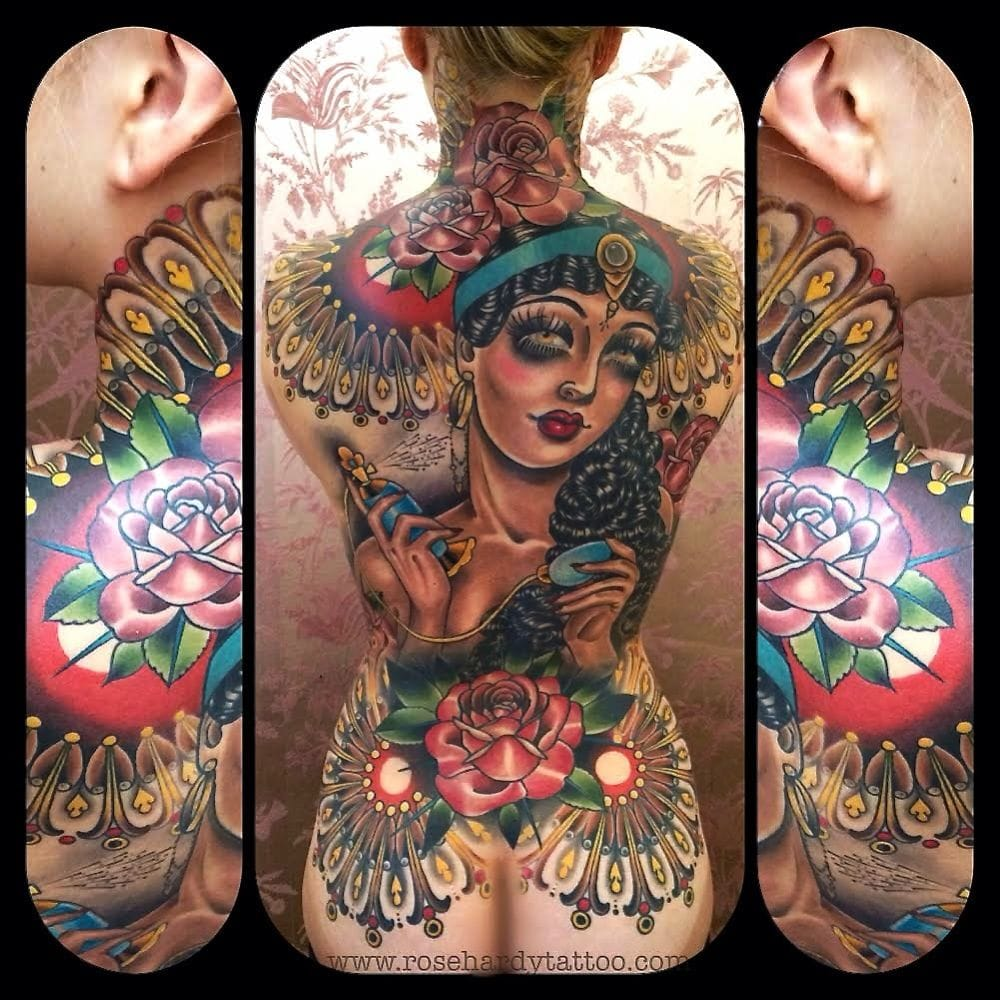 Badass backpiece with a lady putting perfume on by neo traditional master Rose Hardy!