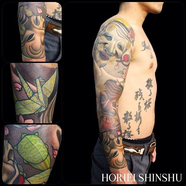 This sleeve, also by Horiei Shinshu, includes several Japanese mask tattoos.