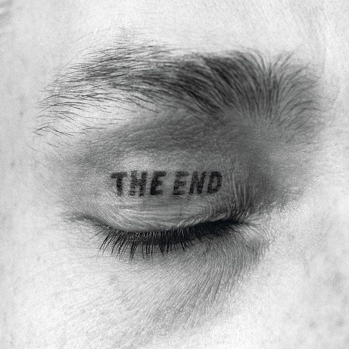 the end tattoo