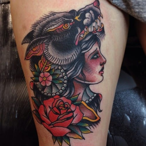 Sometimes, girl's heads are rendered with animal heads on top of them to signify valiance or bravery, or for other reasons which the bearer only knows. Tattoo by Joe Ellis.