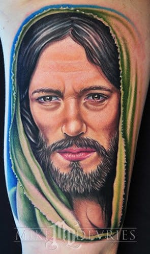 """This colored portrait tattoo was done by Mike Devries, inspired by the movie """"The Passion of The Christ""""."""