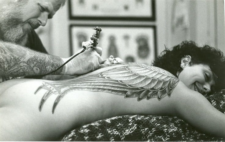 1980s Bob Roberts tattooing a back piece