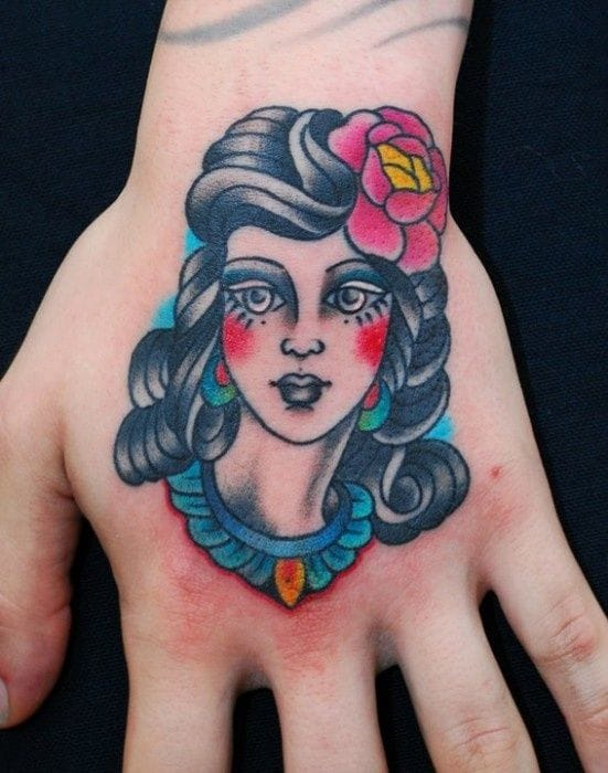 Girl's heads are also perfect on the hands. Tattoo by Miss Arianna.