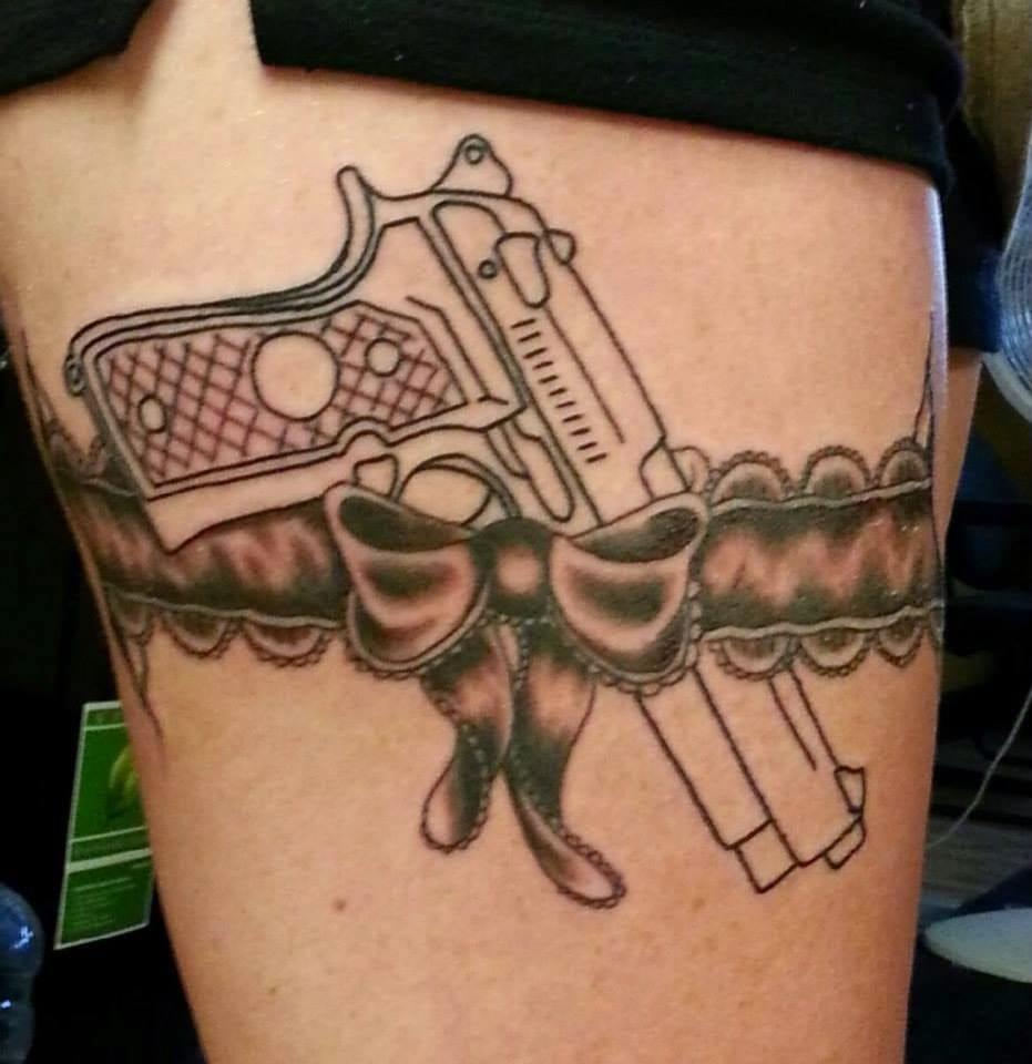 lace garter gun tattoo