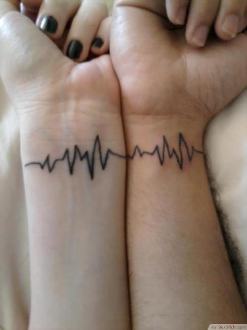 Matching heartbeat tattoos