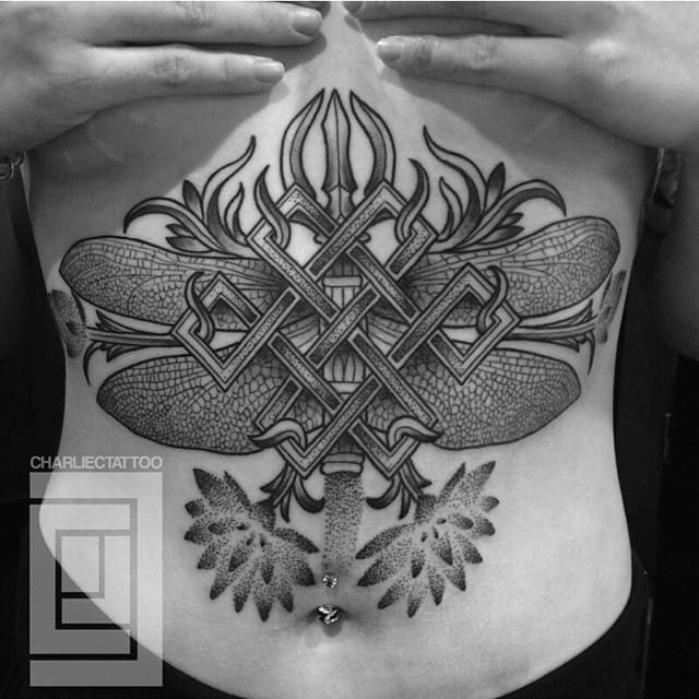 Or some badass sacred geometry, just like this stomach tattoo by Charlie C?