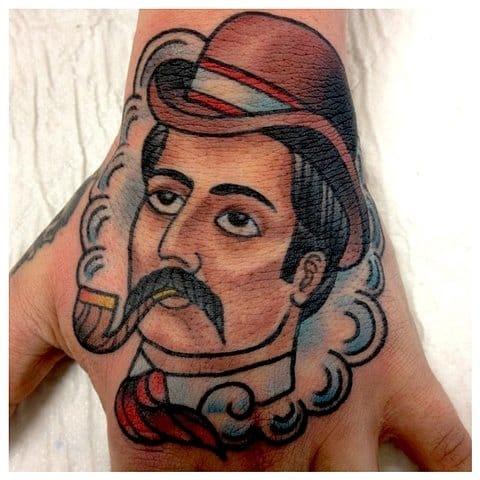 Gentleman hand tattoo, artist unknown