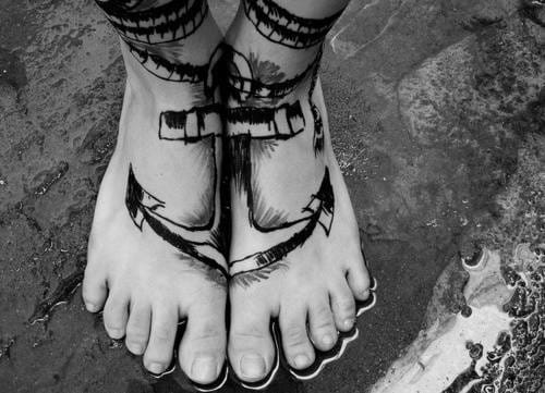 A clever placement for this tattoo, reminding to its owner not to sink !