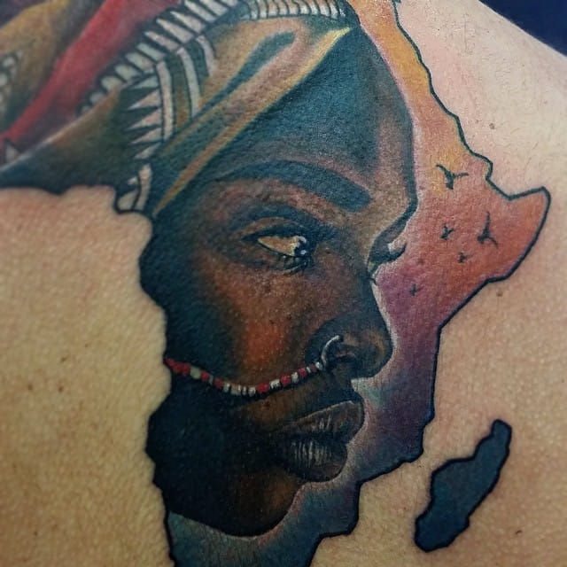 The outline of the Africa continent is perfect to include another design, often the face of a beautiful African woman. Here by Miguel Angel Espinosa.