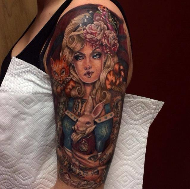 Awesome half sleeve with a tattooed Alice in Wonderland by Mike Carro!