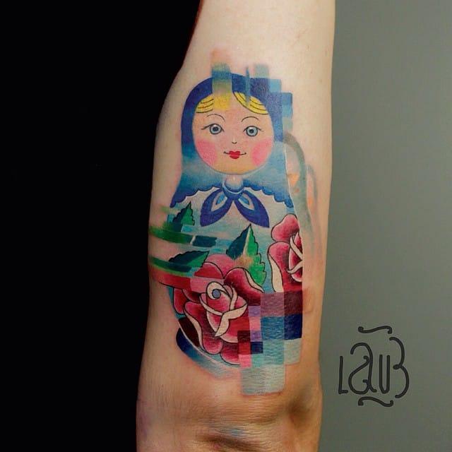 For more pixel tattoos, check Lesha Lauz's portfolio.