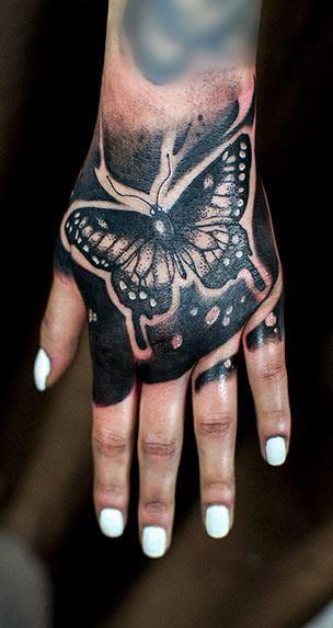 Badass blackwork hand by Evan at Chronic Ink!  #Butterfly #ButterflyTattoo