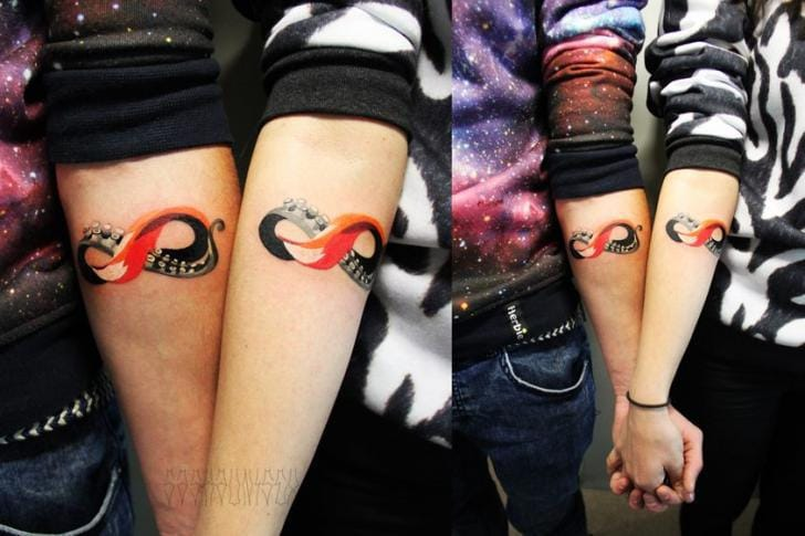 A twist to the infinite symbol with a tentacle and a fox tail by Sasha Unisex.