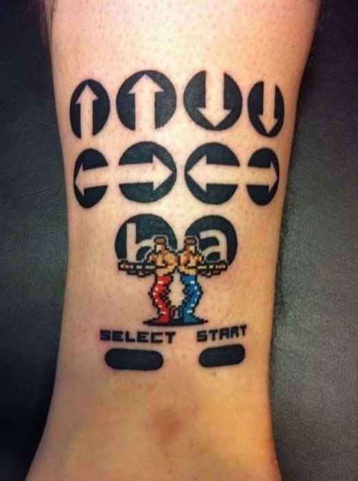 Love the pixelated characters on this one! It suddenly changes the look of the whole tattoo.