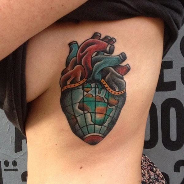 Heart combined with the world tattoo