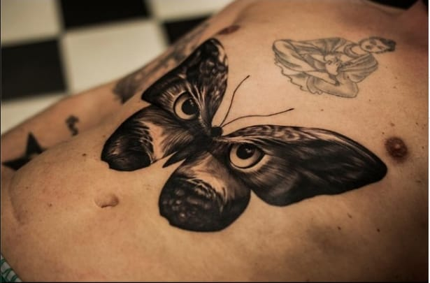 Butterfly-owl tattoo by Oscar Akermo