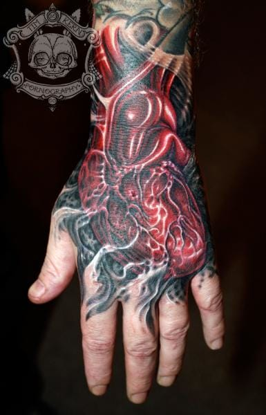 Heart Biomechanical Tattoo by Tim Kerr