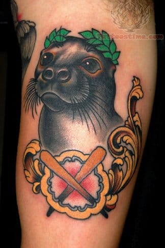 Cute seal tattoo by Jim Sylvia