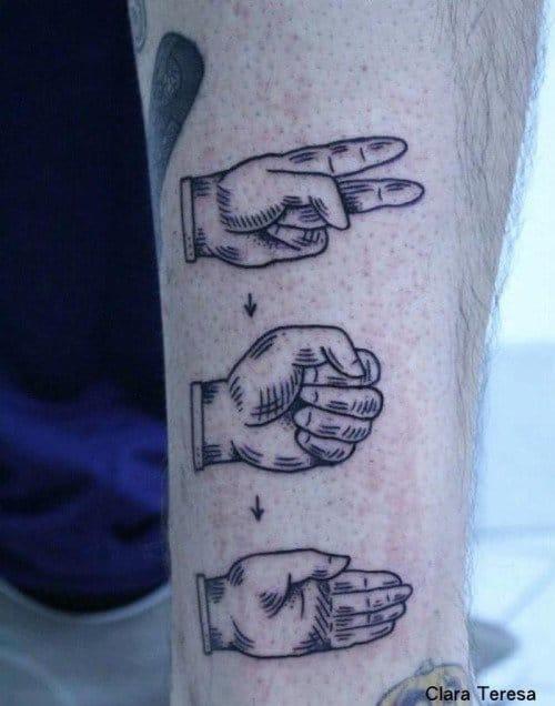 Rock paper scissors tattoo by Clara Theresa.