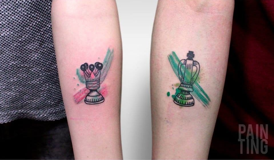 Matching tattoos: king and queen.