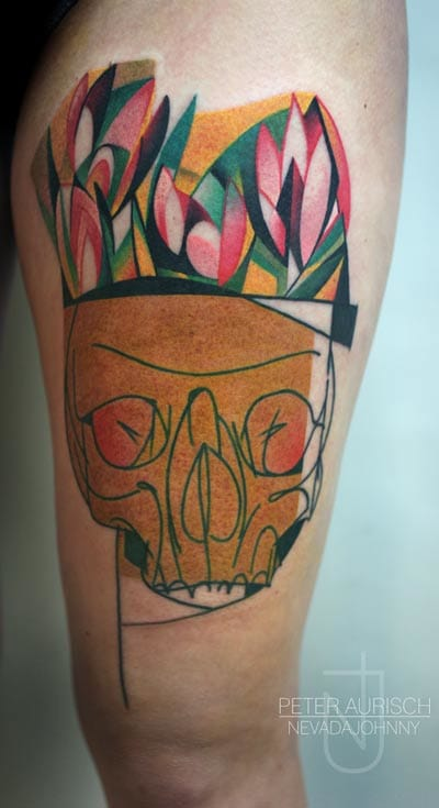 Notice the color choices in this outsanding skull flower piece.
