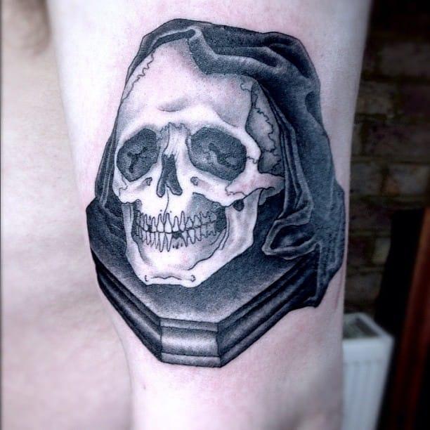 Black and grey skull tattoo